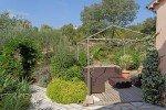 Sitzecke an der Küche mit Garten im Hintergrund Ferienhaus Latour mit Panorama-Meerblick