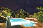 Villa Aurelia Ferienhaus in Les Issambres Côte d'Azur Südfrankreich-Pool beleuchtet Palmen Garten bei Nacht
